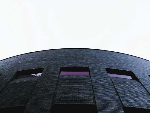 architecture grey high rise building structure brick