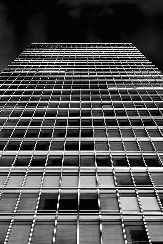 architecture low angle photography of high-rise building black-and-white