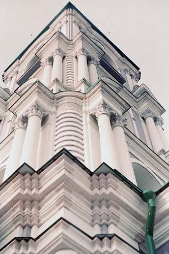 architecture low angle photography of white concrete building tower