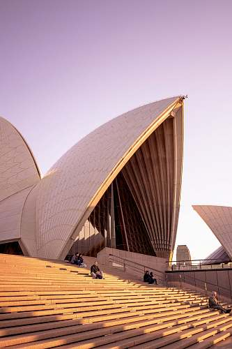 architecture people sitting on bench on Sydney Opera House during daytime human