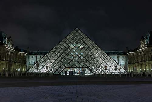 architecture pyramid-shaped clear glass building during night pyramid
