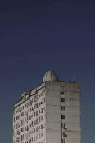 dome white multi-storey concrete building architecture