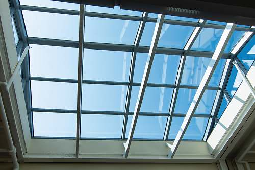 architecture white wooden framed glass ceiling during daytime window