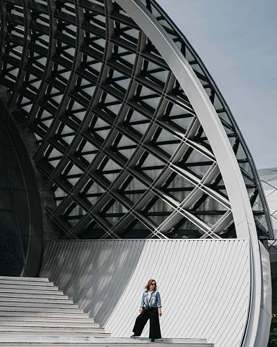 architecture woman standing on stairs planetarium