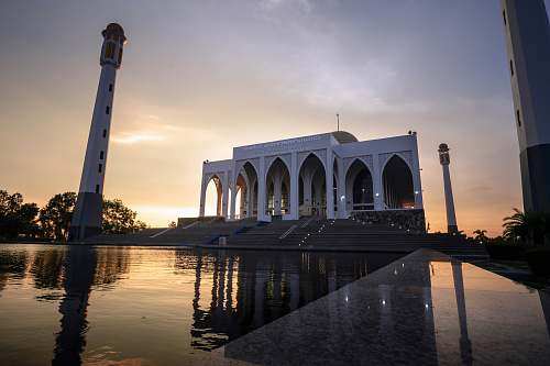 building white mosque with pond in front architecture