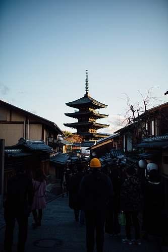 temple people walking on street near houses during daytime worship