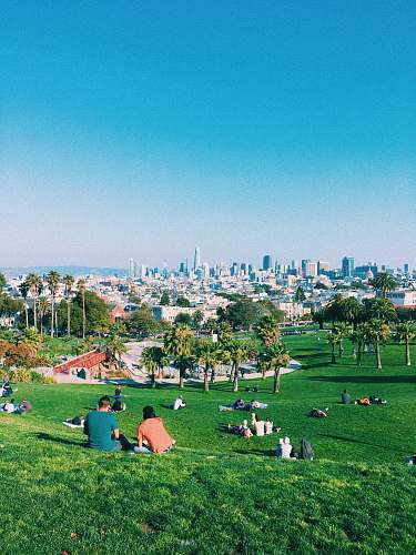 san francisco people resting on green grass park ca 94114