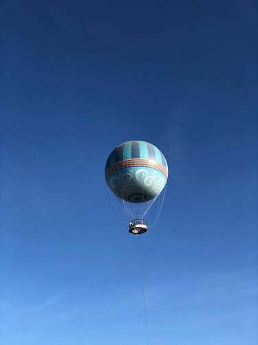 leisure activities flying gray hot air balloon during daytime aircraft