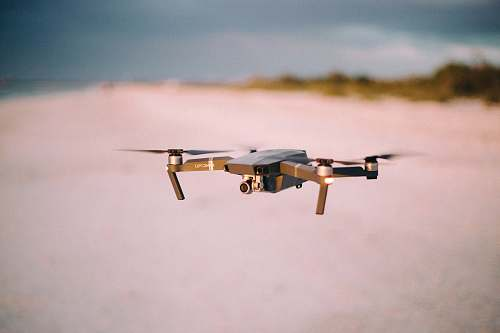 warplane shallow focus photography of flying quadcopter aircraft