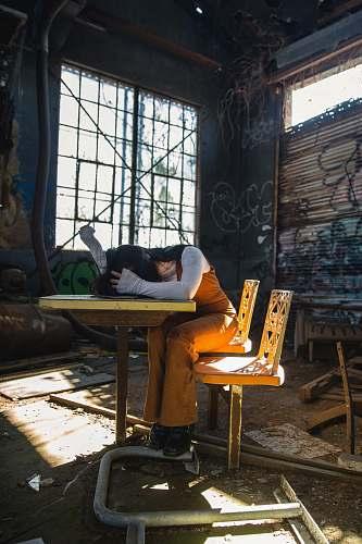 bird woman sleeping on table inside room pigeon