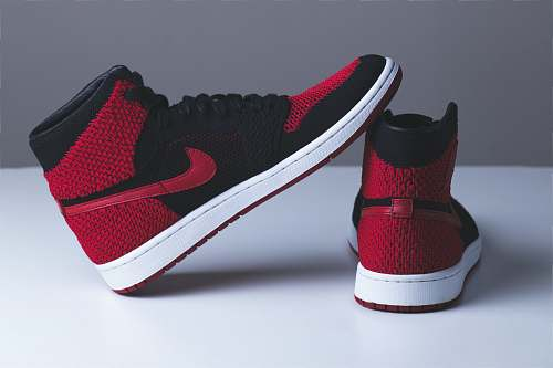 clothing pair of red and black Nike sneakers footwear