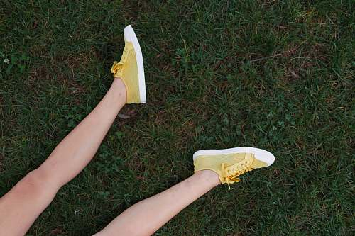 clothing yellow-and-white low-top sneakers footwear