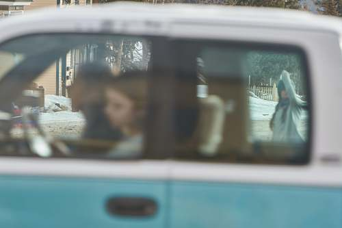 car man and woman riding vehicle transportation