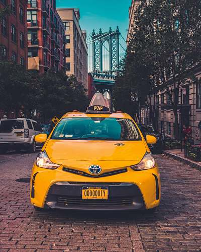 photo cab yellow Toyota taxi cab parked near building car free for commercial use images
