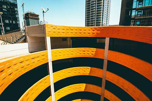 handrail top-view photography of spiral building rainbow garage