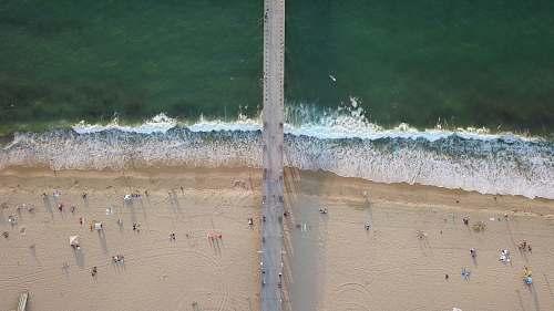 coast bird's eye photography of people at beach ocean