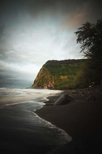 coast mountain beside beach nature