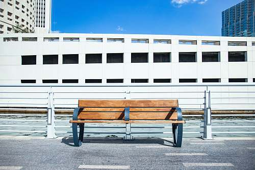 tampa empty brown wooden bench building