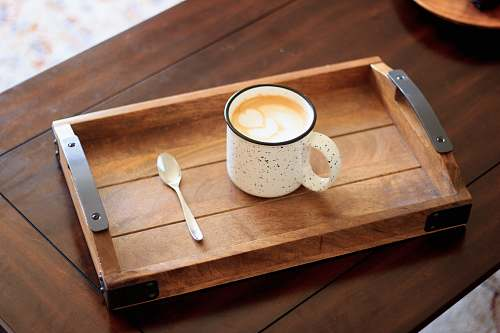 drink white ceramic mug on brown wooden serving tray coffee table