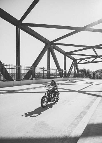 united states grayscale photo of man riding motorcycle on bridge minneapolis