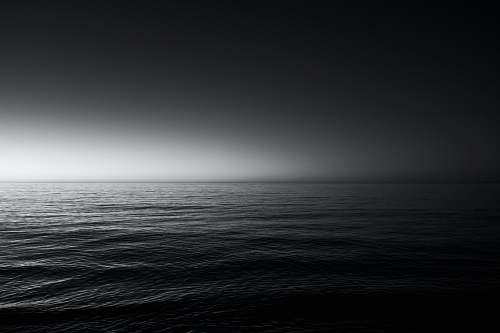 grey grayscale photo of sea water