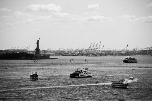 boat grayscale photo of ships on body of water vehicle