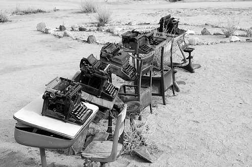 pioneertown grayscale photo of typewriter on tables desk
