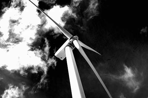 whitewater grayscale photography of windmill cross