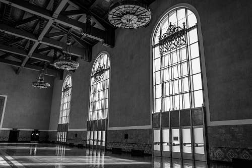 prison hallway with three large arch-shaped windows los angeles