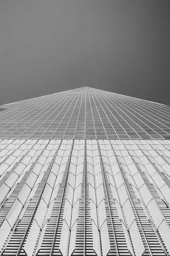 building low angle photography of high rise building grey