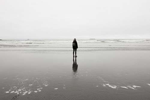 grey person standing near sea at daytime ruby beach
