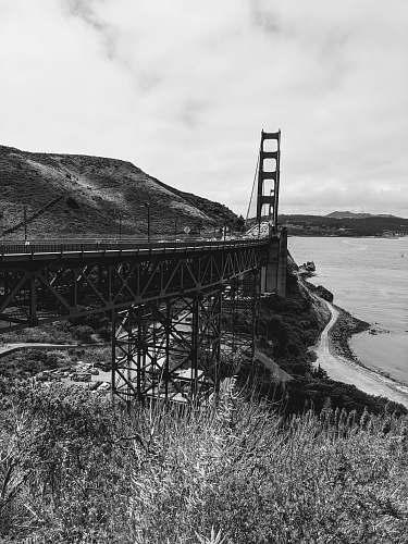 building road leading to Golden Gate Bridge near shore bridge