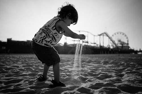 human toddler playing beach sand people