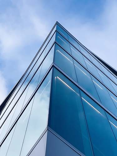 building low angle photography of glass building office building