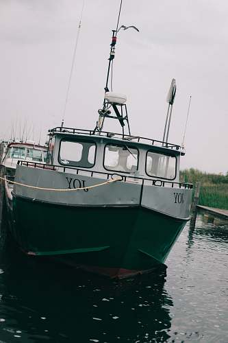 vessel white and green boat transportation