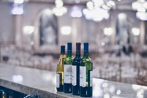 manhattan shallow focus photography of wine bottles alcohol