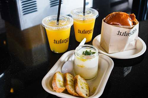 food two clear plastic cups filled with yellow liquid los angeles