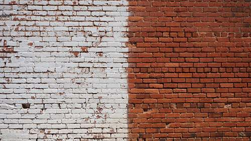 background photo of white and brown bricked wall during daytime wall