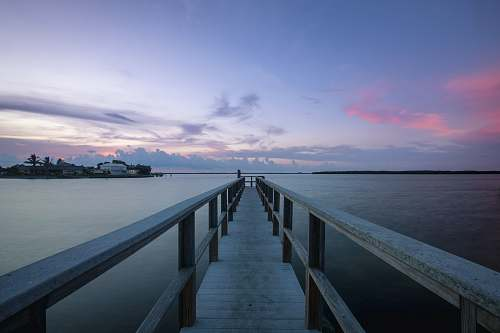 boardwalk gray wooden beach dock during calm waters building
