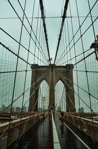 building man riding bike on bridge human