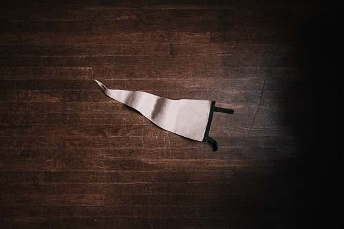 minimal white pennant on brown surface flat lay