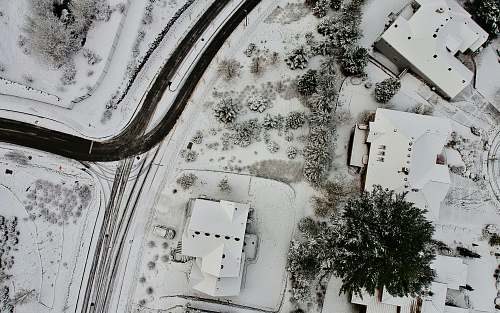house aerial photography of houses coated with snow happy valley