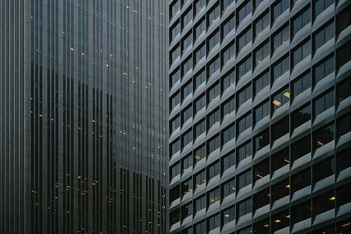 grey architectural photography of glass curtain buildings architecture