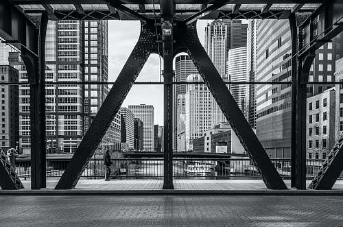 black-and-white architectural photography of metal buildings bridge