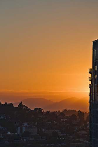 architecture city building across mountain during sunset tower