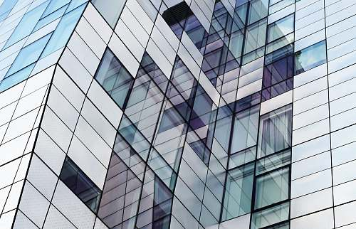 architecture closeup photography of glass window building new york