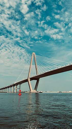 bridge gray concrete bridge under white clouds suspension bridge