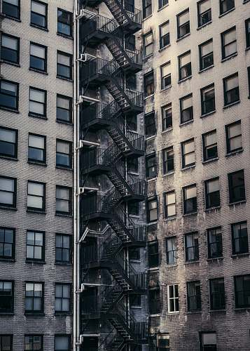 city gray concrete buildings with metal exit stairs urban