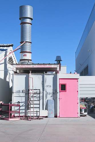 beacon gray metal shed with pink door power plant