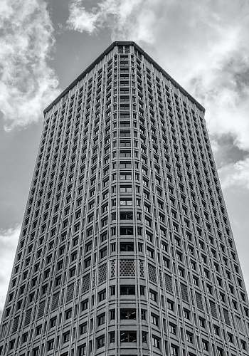 black-and-white grayscale photography of high-rise building office building
